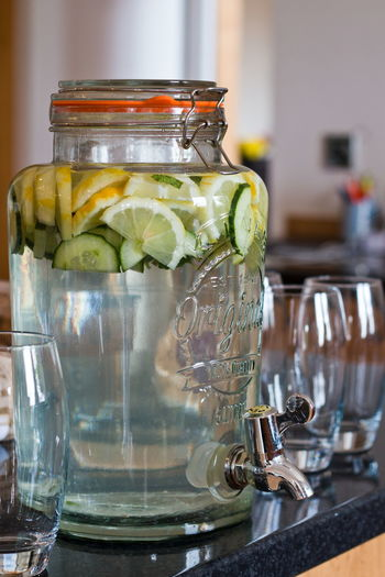 Cucumber and lemon water in a jug Cucumber Water Summer Drink Drink Lemon Water Healthy Lifestyle Healthy Eat Clean Refreshing :) Refreshment EyeEm Selects Drink Water Drinking Glass Jar Cafe Close-up Food And Drink Mason Jar Lemon Detox