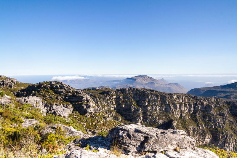 View of rocks and mist on Table Mountain Beauty In Nature Blue Cape Town Capetown Clear Sky Day Holidays Landscape Mountain Nature No People Outdoors Rock - Object Rocks Scenics South Africa South Fargo Table Mountain Tourism Travel Destinations Vacations Vintage Vista