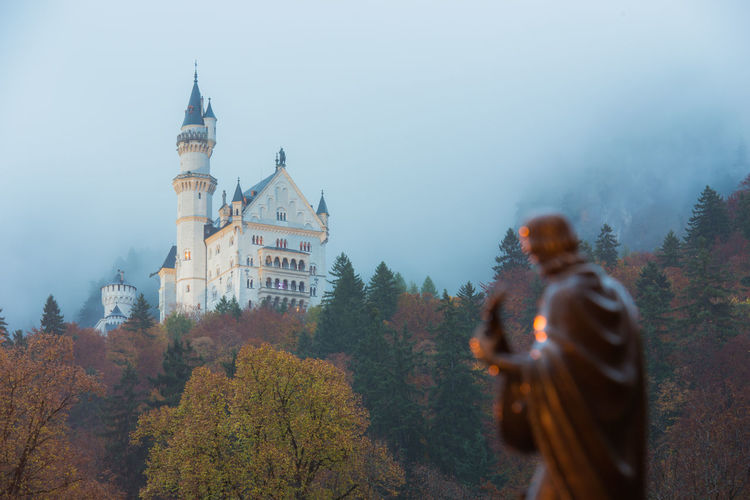 Neuschwanstein Castle with Autumn colors, Fussen, German Tree Architecture Plant Building Exterior Built Structure Autumn Building Nature Day Change Fog Real People Travel Destinations Travel Religion History The Past Place Of Worship Lifestyles Outdoors