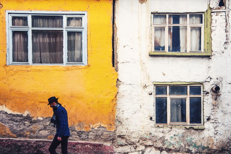 Paint The Town Yellow Window Building Exterior Architecture Outdoors Yellow One Person Day One Man Only Real People City Photographing The Week On Eyem The Week Of Eyeem Men Check This Out Street Photography