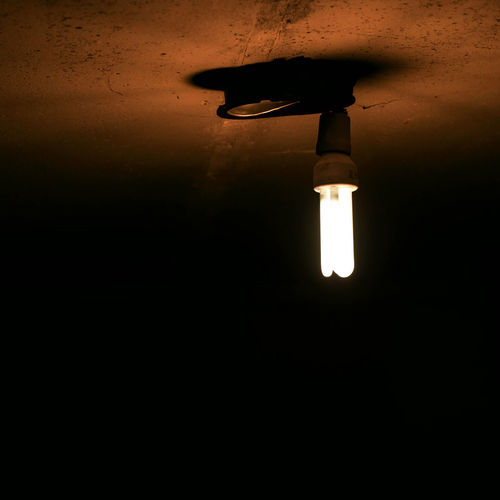 Light bulb in dark room Ceiling Copy Space Dark Darkroom Domestic Room Electric Lamp Electric Light Electricity  Glowing Home Interior Illuminated Indoors  Light Light - Natural Phenomenon Light Bulb Light Fixture Lighting Equipment Low Angle View Night No People Technology Wall - Building Feature