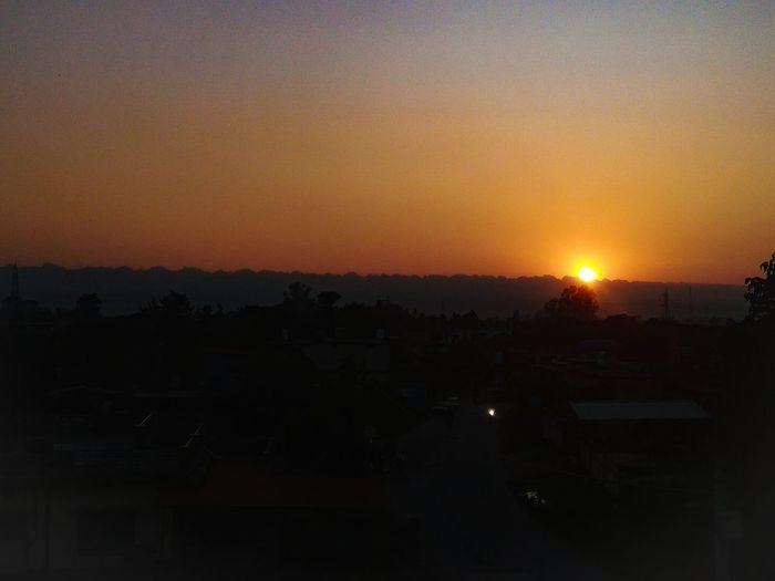 Astronomy City Cityscape Sunset Sun Illuminated Orange Color Sky Architecture Built Structure