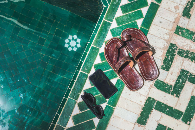 Morocco Lifestyle Travel Marrakesh Craft Sandal Summertime Vacations Absence Architecture Built Structure Day Flooring Green Color High Angle View Leisure Activity Nature No People Outdoors Pattern Pool Reflection Summer Sunlight Swimming Pool Tile Tiled Floor Water
