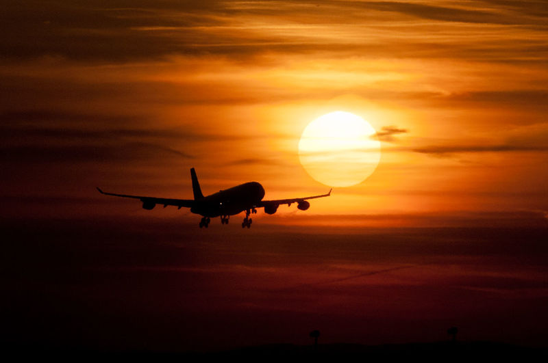 Travel to Sun! AirPlane ✈ Cloud Cloud - Sky Cloudy Dramatic Sky Flying Journey Mode Of Transport Orange Color Scenics Silhouette Sky Sun Sunset Take Off