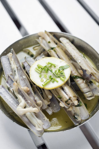 white wine garlic steamed razor clams Razor Clams Bowl Close-up Day Food Food And Drink Freshness Healthy Eating High Angle View Indoors  No People Plate Portuguese Food Ready-to-eat Still Life Vegetable