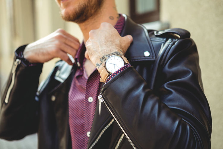 Young Man casually dressed wearing analog watch in the Urban environment Men Focus On Foreground Real People Midsection One Person Adult Holding Lifestyles Indoors  Day Hand Casual Clothing Standing Males  Human Hand Leisure Activity Clothing Front View Time Leather Watch Wrist Watch Jewellery Jewelry Young Adult Young Men City City Life Urban Street