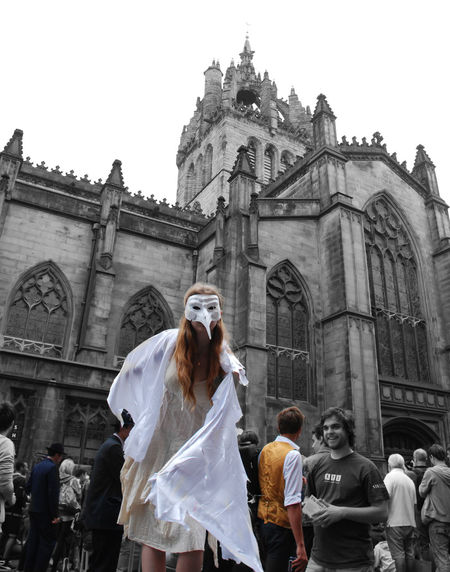 Edinburgh Fringe Architecture Building Exterior Built Structure Day Festival Large Group Of People Lifestyles Low Angle View Outdoors People Place Of Worship Real People Religion Sculpture Selected Color Sky Spirituality Statue Togetherness Women