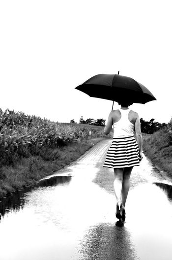 Rain Adult Blackandwhite Day Full Length Leisure Activity Lifestyles Nature One Person Outdoors Protection Rain Rainy Season Real People Rear View Security Sky Umbrella Walking Water Wet Women EyeEmNewHere