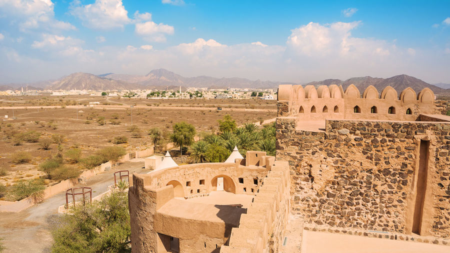Terrace of the fort of Jabrin and in the background of Bahla and date crops (Oman) Fort Bahla Castle Oman Jabreen Castle Fortifications Arab Travel Travel Destinations Tourism Old Islamic Fortress Middle East Sultanate Of Oman Landmark Jibreen Panorama