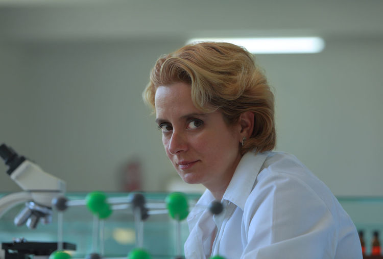 Portrait of a female researcher in a laboratory. Portrait Headshot One Person Indoors  Focus On Foreground Healthcare And Medicine Occupation Education Blond Hair Science Laboratory Looking Adult Lab Coat Scientist Real People Research Woman Woman Portrait Female Researcher Life Researcher Female Researcher Science Lab Medical Research Chemistry University School