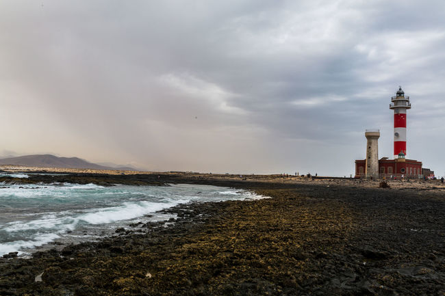 Canarias Colors Field Fuerteventura Winter Architecture Beach Blackandwhite Building Building Exterior Built Structure Cloud - Sky Direction España Faro Guidance Island Land Lava Lighthouse Nature No People Outdoors Protection Safety Sea Seascape Security Sky Storm Cloud Tost Tower Water EyeEmNewHere