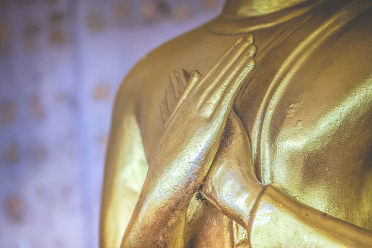 A Statue Of Buddha Image With Close-Up Of The Hands. Ancient Arm Art ASIA Buddha Image Buddhist Close-up Destination Detail Eye4photography  EyeEm Best Shots Faith Faithful Hands Historic No People Photography Religion Statue Symbol Temple Thailand Worship