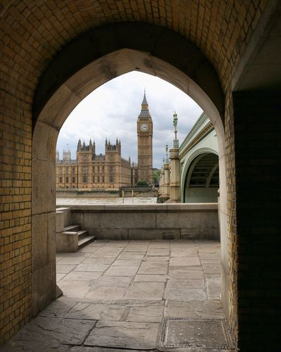 Big ben by thames river seen from archway