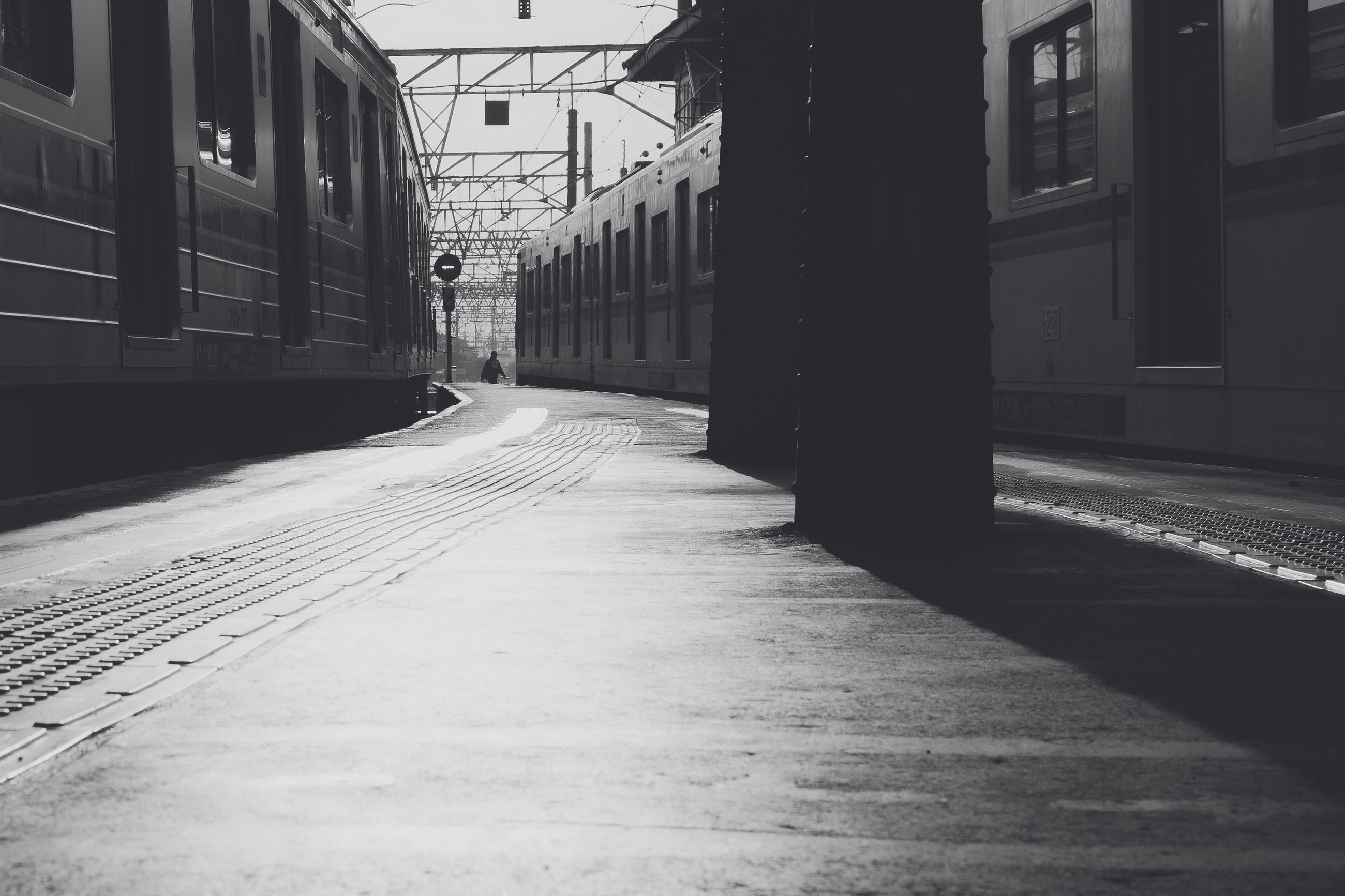rail transportation, architecture, public transportation, built structure, building exterior, railroad track, track, transportation, train, train - vehicle, railroad station platform, railroad station, mode of transportation, no people, the way forward, direction, city, day, outdoors, street, station