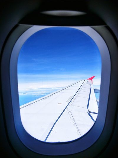 ✈airplane window Passenger Passenger Craft Sky And Clouds Wing Of Plane Airplane Blue Flying Winter Snow Mountain Sky Aircraft Wing Airfield Propeller Airplane Landing - Touching Down Commercial Airplane Air Vehicle Jet Engine Runway Aerospace Industry