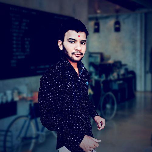 Portrait of young man standing indoors