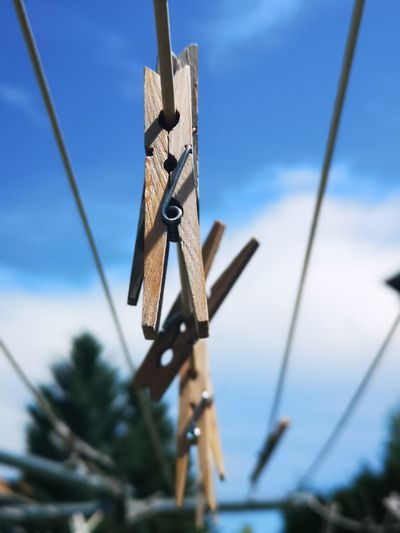 Clothes lines and pins in the sky... Clothes Dried Outside Smell The Best Clothes Lines Clothes Pins No People Unedited Color Photo Different Perspective Beauty In Ordinary Things Rusty Blue Metal Sky Close-up The Mobile Photographer - 2019 EyeEm Awards The Creative - 2019 EyeEm Awards My Best Photo