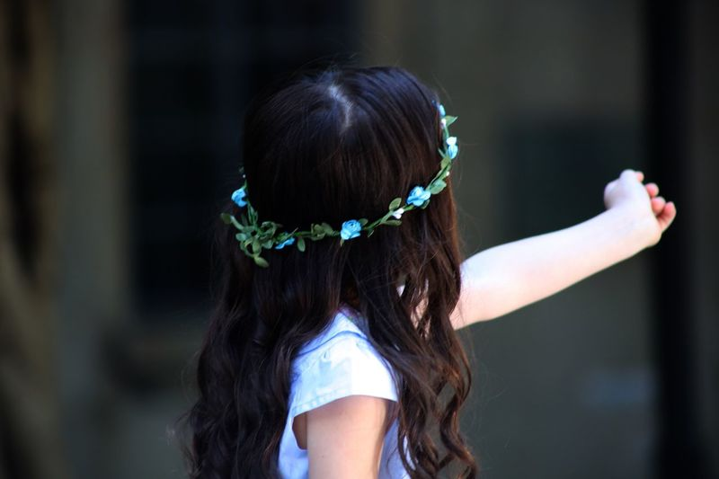 Rear View Of Girl Wearing Floral Wreath