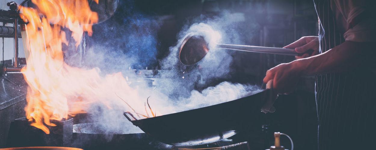 Panoramic shot of people preparing food