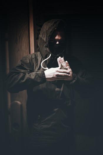 Man smoking cigarette at night