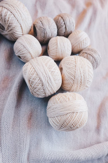 Textile Still Life No People Close-up Wool Art And Craft Indoors  Craft Ball Of Wool Creativity Material Large Group Of Objects Group Of Objects Pattern Softness Neutral Colors Yarn Yarn Balls Cotton Cotton Balls Strings