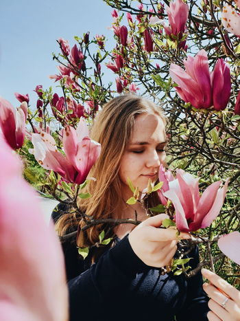 Flower Young Women Beautiful Woman Beauty Close-up Sky Magnolia Blossom Plant Life Spring Botany Flora Blooming Petal Blossoming  Botanical Perfume Flower Head In Bloom