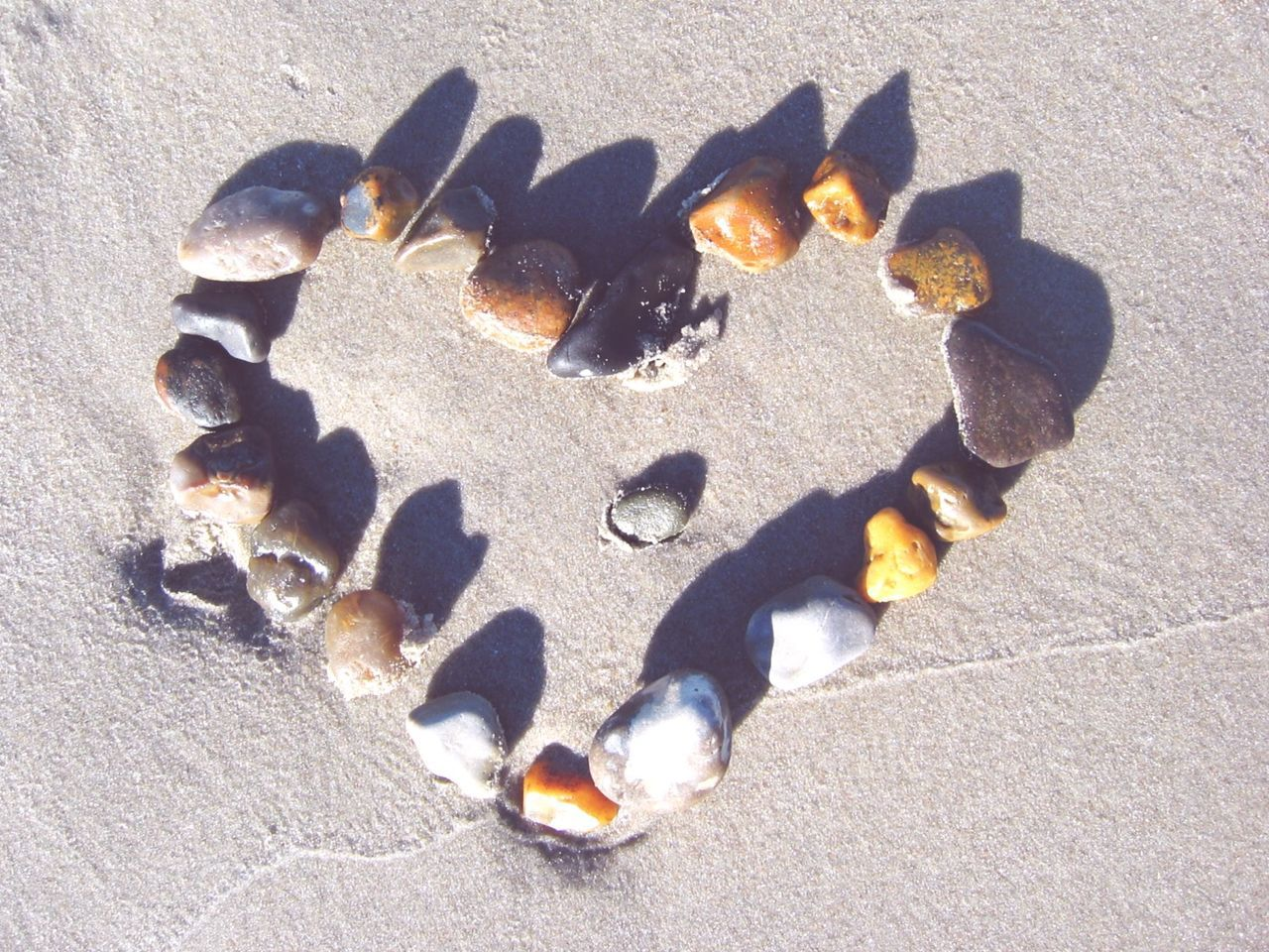 Close-Up Of Heart Made By Stones At Beach