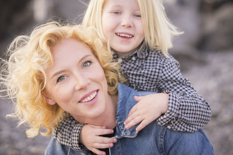 cheerful and happy couple mother and young children son having fun together - mom carry his little boy on her shoulder and both laugh and smile - bright sunny colors and concept of happiness and love in family Smiling Two People Emotion Togetherness Blond Hair Hair Happiness Bonding Females Child Women Portrait Girls Love Childhood Casual Clothing Positive Emotion Family Adult Hairstyle Daughter Outdoors Mother Son Love Caucasian Enjoying Life Bright Carry Shoulder Check This Out Front View Sun Sunset Jeans 6-7 Years 40-44 Years