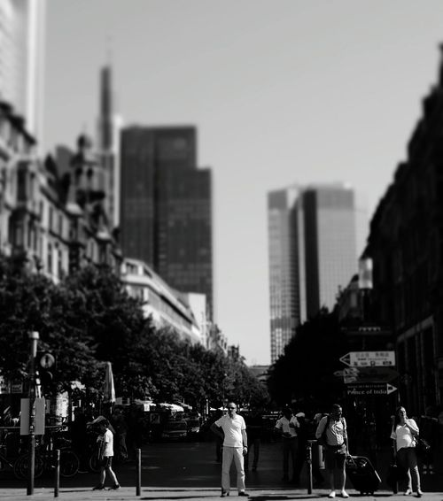 frankfurter Bahnhofsviertel...Architecture City Building Exterior Built Structure Street City Life Road Skyscraper Tower City Street Walking Tall - High Clear Sky Selective Focus Crossing Office Building Travel Destinations Person Building Story Financial District  Monochrome