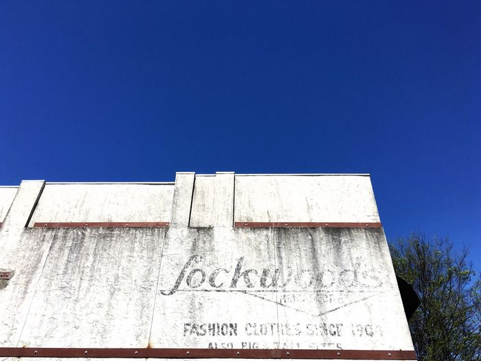 Ghost Signs  Fashion Clothes 1904 Low Angle View No People IPhoneography Blue Sky