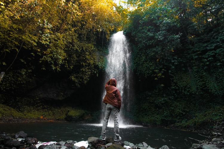 hidden Bali INDONESIA EyeEm Selects Water Tree Waterfall Full Length Motion Women Adventure Splashing Forest Flowing Stream - Flowing Water Stream Long Exposure Hiker Falling Water Ankle Deep In Water Flowing Water