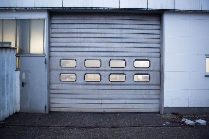Architecture Building Exterior Built Structure Car Car Door Carhood Cars City Close-up Closed Cloudy Corrugated Iron Day Door Garage Garage Door Garages Light Minimalism Minimalist Architecture Minimalistic No People Outdoors Rainy Sunny
