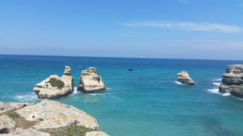 Beauty In Nature Blue Cliff Day Geology Horizon Over Water Idyllic Nature No People Non-urban Scene Orso Outdoors Remote Rock Rock - Object Rock Formation Rocky Salento Puglia Scenics Sea Sky Torre Dell'orso Tranquil Scene Tranquility Water