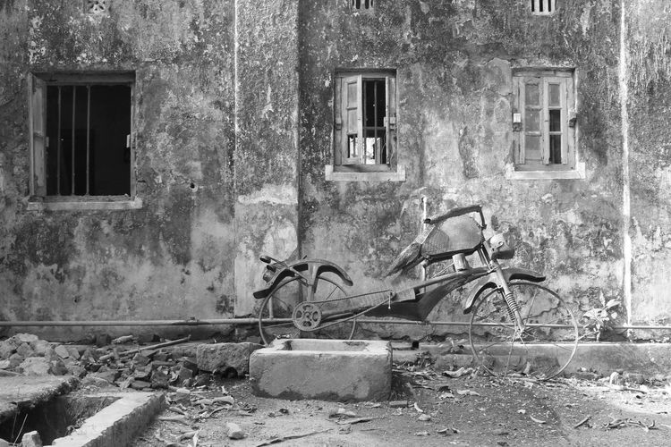 Abandoned Bicycle By Old Building