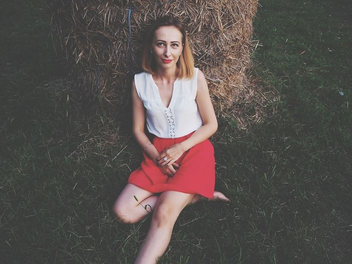 Looking At Camera Portrait Grass Young Women Beautiful Woman Beauty Smiling Happiness Haystack Rewilding Female Model Woman Model Fashion Fashion&love&beauty Red Skirt Red Lips Blond Hair Lifestyle EyeEmNewHere The Week On EyeEm Lost In The Landscape
