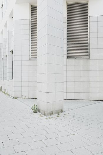 Footpath by building in city