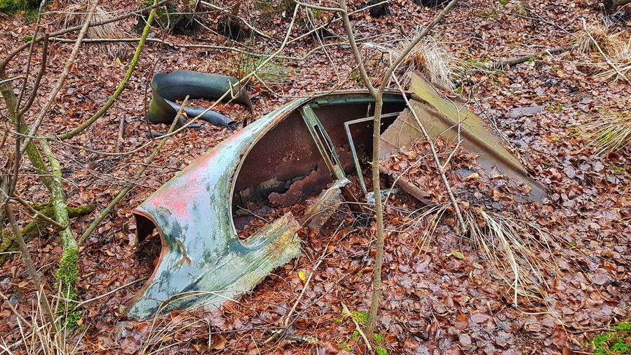 High angle view of old abandoned car on field