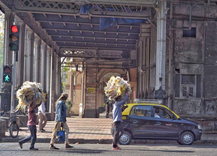 The Street Photographer - 2017 EyeEm Awards Live For The Story BombayCityLife Street Light Neighborhood Map Streetphotography MumbaiDiaries PeopleOfBombay Photowalk Mumbaistreets Streetlight Personal Perspective Motion Speed BombayNighLife City Street