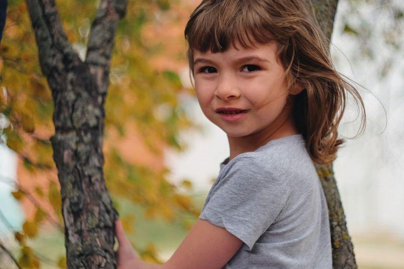 Portrait Of Girl Against Tree