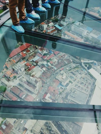 Low section of people on glass