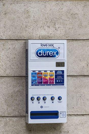 Safe Sex!  Close-up Communication Condom Machine Condoms Contraception Day Durex No People Outdoors Technology Text