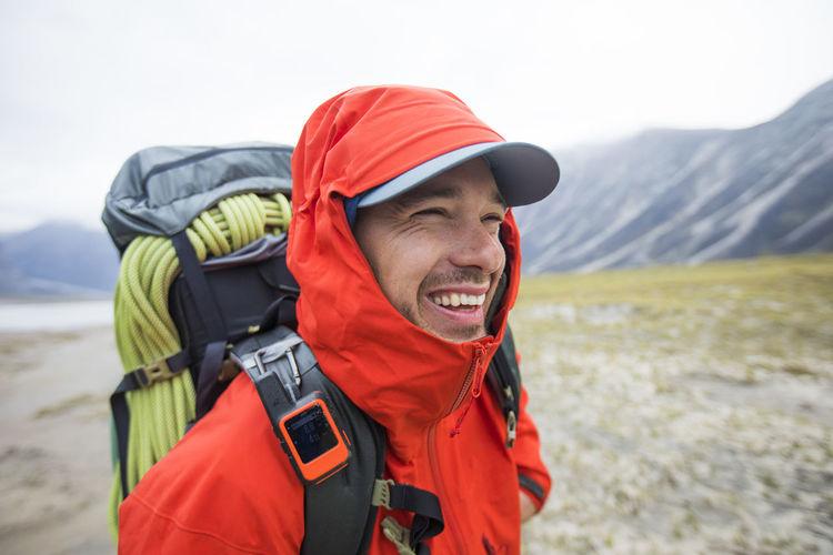 Man wearing hat looking at mountains