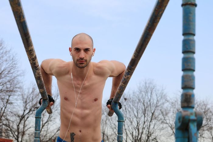 Young man exercising outside Sportsman Sport Sports Photography Outdoor Outside Exercise Exercising Exercise Time Topless, Modeling Model Fit Outdoor Photography