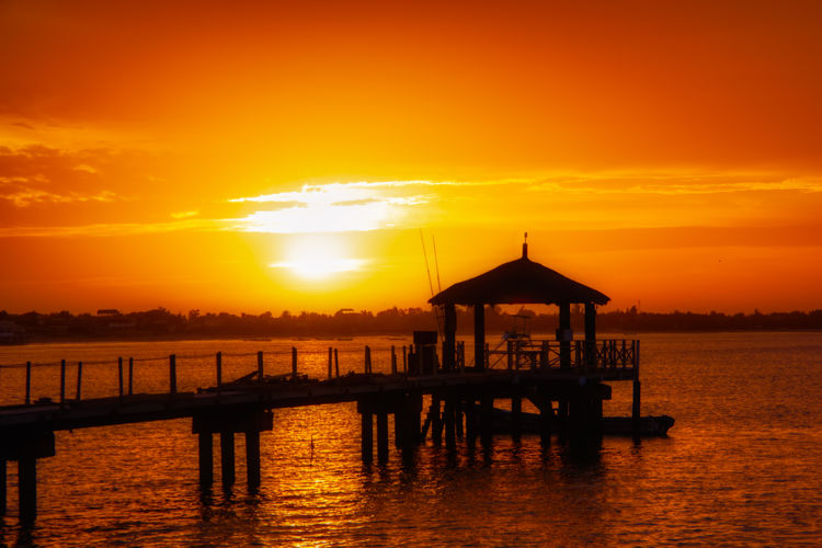 Sunrise on a pier of Sali beach Sunset Sky Water Orange Color Beauty In Nature Scenics - Nature Architecture Sun Built Structure Silhouette Tranquility Tranquil Scene Cloud - Sky Sea Pier Nature Idyllic Waterfront No People Outdoors Wooden Post