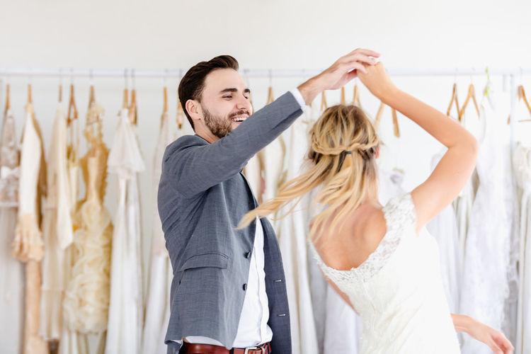 Couple dancing in bridal shop