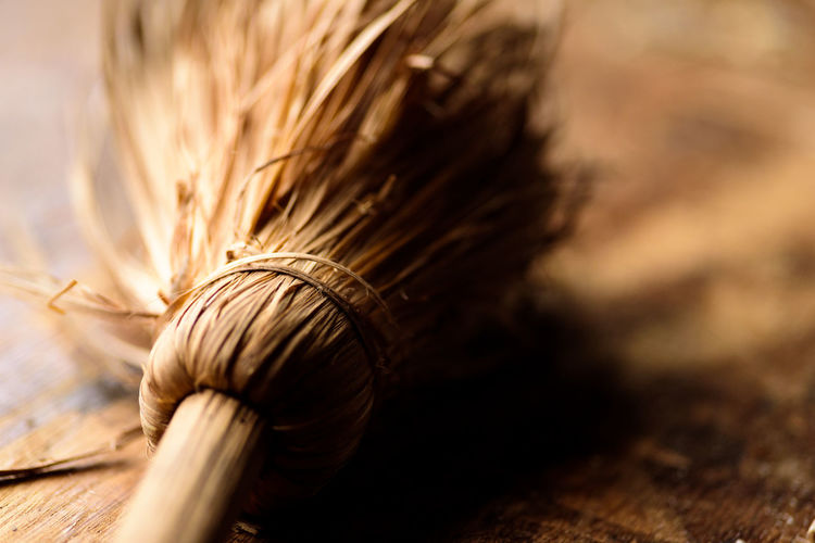 Close-up of broom on table
