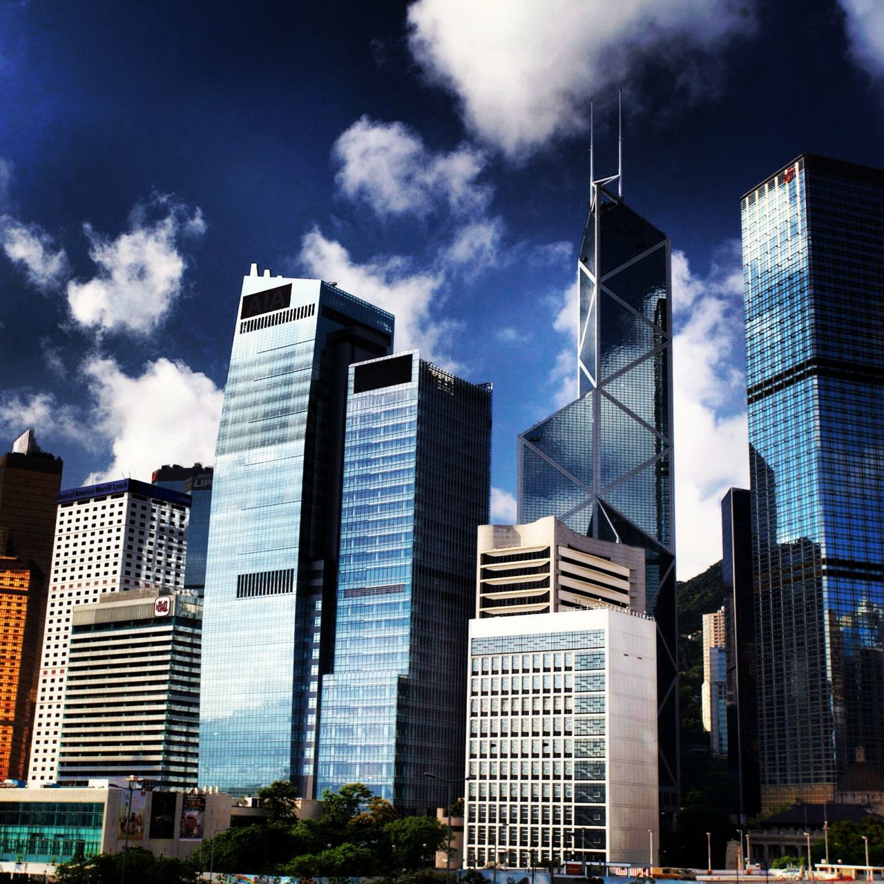 skyscraper, architecture, building exterior, modern, sky, city, built structure, cloud - sky, day, outdoors, low angle view, no people, tall, growth, urban skyline, cityscape, office park