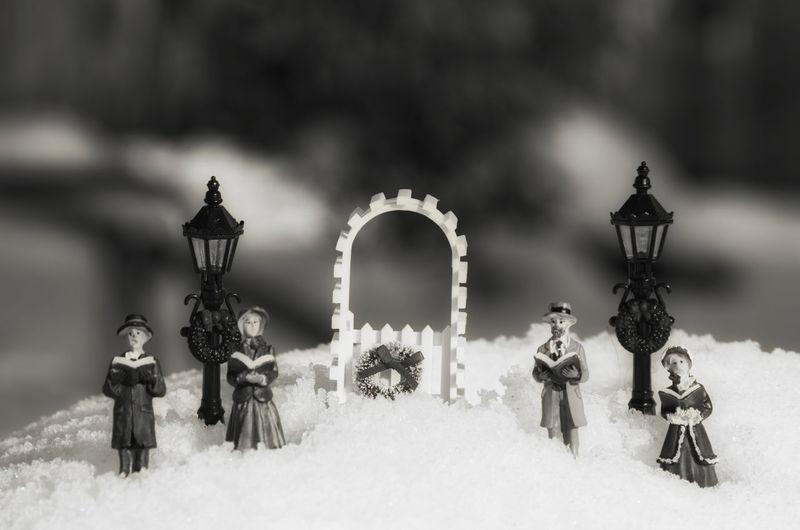 Close-up of figurines on snow