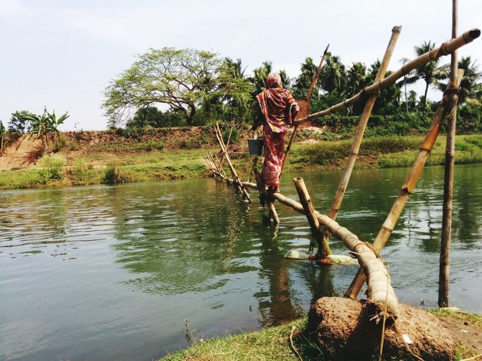 Crossing a river in India Looking To The Other Side