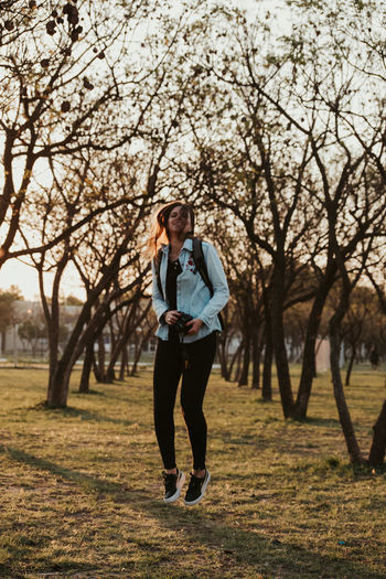 Full length of teenage girl standing on field